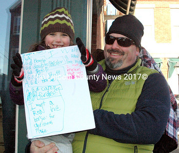 Zofie Day, 6, came prepared with her list for Santa. She and her dad Justin made a special trip from Greenville to see Santa in person. (Eleanor Cade Busby photo)