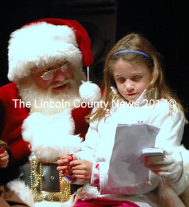 Mya Bessey, 7, brought Santa a thank you note for all the wonderful work he does plus a thank you in advance for her surprises this year. (Eleanor Cade Busby photo)