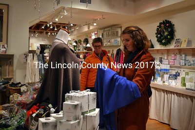 Erin Stodder of Whitefield looks over the shawls at In the Clover in Wiscasset during Small Business Saturday. (Kathy Onorato photo)