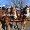 Guided by Alna's Jay and Linda Verney, Belgian horses offered residents scenic wagon rides through downtown Wiscasset on Dec. 7.  (Kathy Onorato photo)