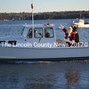 Santa Claus, Rudolph and Frosty arrive in Wiscasset Dec. 7 via the lobster boat Angelina helmed by Jody Haggett. (Kathy Onorato photo)