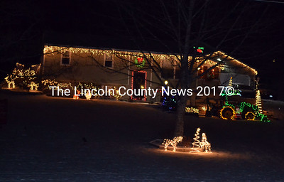 Even the John Deere tractor is lit up in this holiday display in Wiscasset. (Kathy Onorato photo)