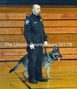 After a drug search at Wiscasset High School Dec. 19, Detective Scott Hayden of the Lincoln County Sherrif's Office introduces his K9 partner Koda to students. (Kathy Onorato photo)