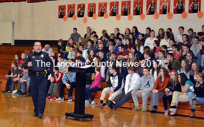 Wiscasset High School students listen as Chief Troy Cline shares information about the impact drugs may have on their lives. (Kathy Onorato photo)