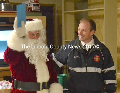 Waldoboro Fire Chief Paul Smeltzer thanks Frank Overlock for serving as Santa Claus for the last 27 years. (D. Lobkowicz photo)