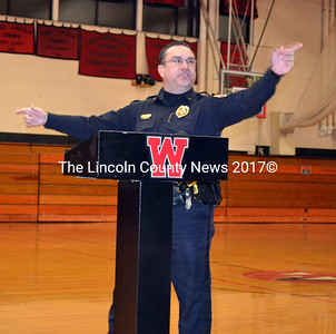 Wiscasset Police Chief Troy Cline addresses the student body at Wiscasset High School Dec. 19. (Kathy Onorato photo)