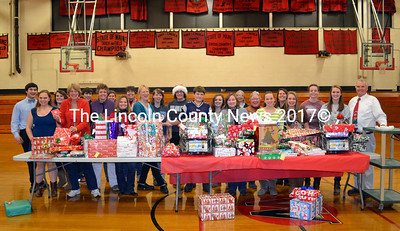 Wiscasset High School students and staff collected enough gifts to make a happier Christmas for two Maine families. (Kathy Onorato photo)