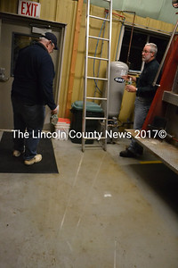 "Nobleboro Selectman Chair Dick Spear (left) and Selectman Walter ""Al"" Lewis take a look at the flooding in the Minnehata Fire Station kitchen Dec. 18.  (D. Lobkowicz photo)"