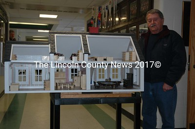 Great Salt Bay Community School bus driver Allan Ray stands next to the Cape Cod dollhouse he built at his Newcastle workshop. The proceeds from a raffle for the dollhouse will benefit the annual Bike Rodeo. Tickets are available at the school office or from any bus driver or custodian. (J.W. Oliver photo)