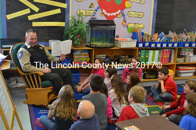"Major Ken Mason, of the Lincoln County Sheriff's Office, reads Shel Silverstein's ""The Giving Tree"" to Sarah Brewer's first and second grade combination class at Whitefield Elementary School. (D. Lobkowicz photo)"