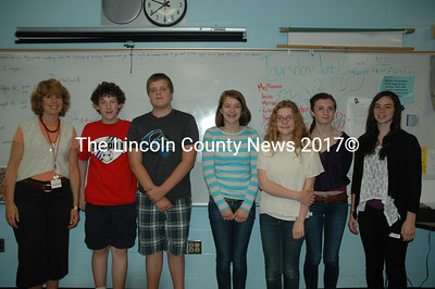The Great Salt Bay Community School debate team conducted a mock debate in front of an audience of classmates and staff June 14 and are (from left): teacher Anne Tibbetts Plummer, debate team members Jacob Brown, Caleb Eugley, Emily Ford and Phoebe Pugh, and debate judges Allison Wehrle and Elise Dumont of the Lincoln Academy debate team. (J.W. Oliver photo)