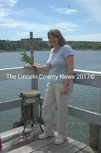 Pastor Kathleen Maclachlan leads the Blessing of the Fleet. (E. Busby photo)