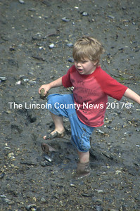 Eli Jones, 3 1/2 provided a moment of fun for the congregation when his boots got stuck in the mud. (E. Busby photo)