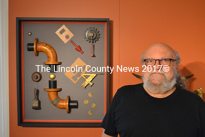 Artist John Sideli stands with one of his mixed media assemblages. (D. Lobkowicz photo)