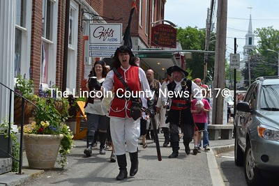 Sergeant Slaughter (Sandi Bilbo of Rockland) leads a band of pirates and unruly soldiers toward Damariscotta Bank and Trust. (J.W. Oliver photo)