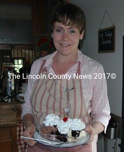 Joan Thompson serves a hot fudge sundae at the Wabi Sabi Cottage ice cream parlor. (J.W. Oliver photo)