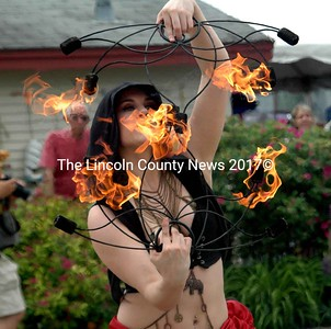 "Fire-breathing dancer ""September"" from Haus Paradigm brought cheers from the crowds. (E. Busby photo)"