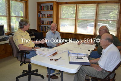 The Westport Island RSU Withdrawal Committee meet June 19 to determine their next steps in negotiating a withdrawal agreement from the Sheepscot Valley Regional School Unit. Left to  right, Dennis Dunbar, Richard DeVries, Gerald Bodmer, and Mort Mendes. (Charlotte Boynton photo)
