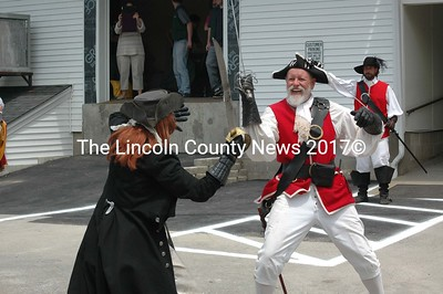 Bloodthirsty Barbara and Capt. Crud Beard (Barbara and Tomm Tomlinson of Rockport) battle behind Renys Underground. (J.W. Oliver photo)