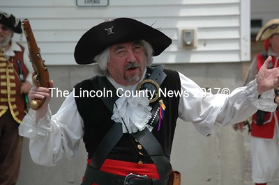Greg Latimer of Waldoboro, aka the Pirate Scribe, attempts to join the pirates and soldiers in common cause to rob a nearby bank. (J.W. Oliver photo)