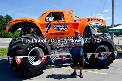 Driver Larry Swim stands with Bigfoot at Sullivan Tire in Damariscotta. (D. Lobkowicz photo)