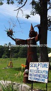 Visitors to Waldoboro's first Locavore Festival were greeted by a recycled wizard, courtesy of Bremen Road sculptor Nathan Nichols. (Shlomit Auciello photo)