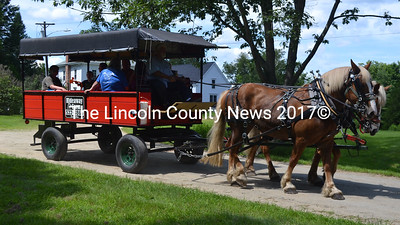 Horses from Hideaway Farm in Topsham took Summerfest attendees on wagon rides around the Pownalborough Courthouse property. (D. Lobkowicz photo)