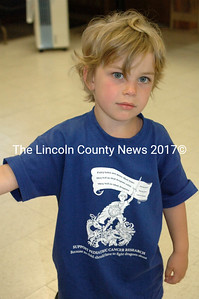 Eli Jones, 3, is Noah's younger brother. Eli helped all afternoon, greeting guests at the American Legion. (E. Busby photo)