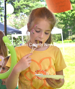 Lydia Valentine, 7, of Farmingdale, takes a bite of the apple pie Shari Lilly entered in the pie-judging contest. (D. Lobkowicz photo)