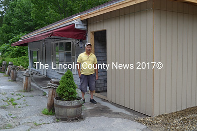 The former Wiscasset Wine Outlet on Route 1 will soon become the town's newest fish market. Owner Ceilico Juntura checks out the renovations being done on the building this past week. He plans to open up shop selling fresh fish and lobsters the first of August, providing renovations are completed in time. (Charlotte Boynton photo)