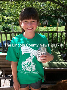 Emma Tolley, 10, from Waldoboro sold lemonade on Sunday to benefit Team Noah Jones. She was distressed that she could not attend the Damariscotta event, so she did her own fundraiser, earning over $110, to help her friend. (E. Busby photo)