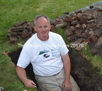 Dr. Thomas Desjardins, historian for the Maine Department of Conservation, at the recent archeological dig at Colonial Pemaquid. (Kim Fletcher photo)