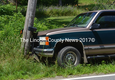 The driver of this pickup said he had to swerve right to miss hitting a trailer as another driver pulled out of a driveway. (D. Lobkowicz photo)