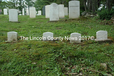 The headstones of the Huston family were completely invisible under out-of-control weeds before the Damariscotta Cemetery Committee began a major clean-up of Walpole Cemetery. (J.W. Oliver photo)