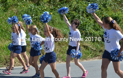 Jefferson Sports Association cheerleaders wave their pom-poms as they march in the parade. (D. Lobkowicz photo)