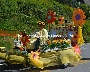 Sharon Morton, of Windsor, rides in the Jefferson Day parade as Flora, the goddess of flowers, on the Willow Grange float. (D. Lobkowicz photo)