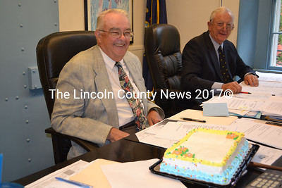 Lincoln County Commissioner William Blodgett, left, is surprised with a birthday cake at the Lincoln County Commissioners meeting on August 20. Commissioner Hamilton Meserve, right, anxioulsy awaits his piece. (Kathy Onorato photo)