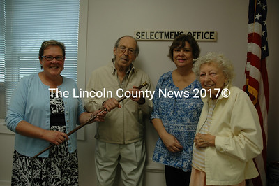Newcastle Selectman Ellen Dickens presents the town's Boston Post Cane to Ellis Travis during an Aug. 30 ceremony at the town office. Newcastle interim Town Administrator Lynn Maloney and Travis's wife, Audrey Travis, were also present for the ceremony. (J.W. Oliver photo)
