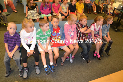 Kindergartners get a front row seat at the opening day assembly at Edgecomb Eddy School. (Kathy Onorato photo)