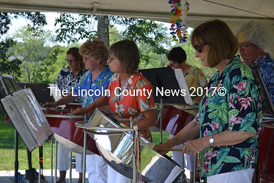 Members of Rockland-based steel drum band Steelin' Thunder serenade festival goers with their music. (D. Lobkowicz photo)