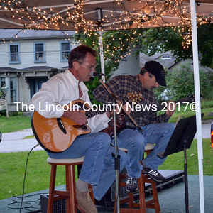 Tim Stegna, left, and J.P. Fisher perform the last Alive on the River concert of the season in Wiscasset on Aug. 29. The duo collected donations for their friend, Mike Nelson, of Nobleboro, who is recovering from injuries from a motorcycle accident. (Kathy Onorato photo)