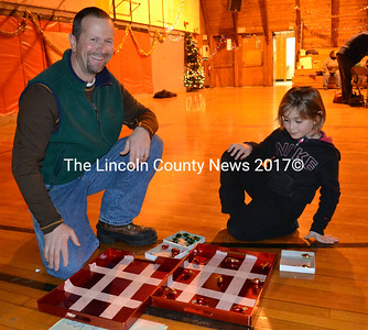 Jody Haggett and his daughter Angelina play a variation of tic-tac-toe during Wiscasset Middle School's Winter Wonderland holiday event Dec. 13. (Kathy Onorato photo)