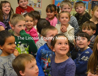 Some kindergarteners look happy, others shocked as runaway gingerbread man Gingy is returned to them on Dec. 13. (D. Lobkowicz photo)
