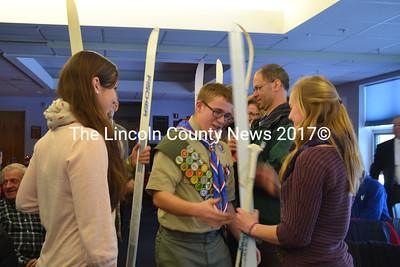 New Eagle Scout David Marcus walks through a gauntlet of friends, making an arch of skis, following his Court of Honor Ceremony, a tradition of the group for many years. (Charlotte Boynton photo)