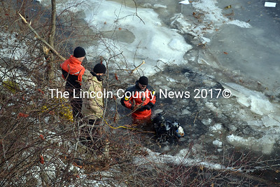 Members of the Maine State Police's Underwater Recovery Team, search the icy Eastern River in Dresden for a vehicle that went in the river following an accident on Route 128 in the early morning on Dec. 13. The search was called off after about an hour and the vehicle is reportedly still in the river. (Kathy Onorato photo)