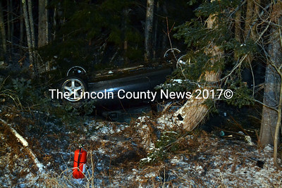 Zachary MacDonald, 19 of Wiscasset, was not injured Friday when the vehicle he was driving ended up on its roof on the Old Bath Road. (Kathy Onorato photo)