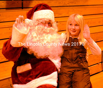 Santa and Izzabella Simmons wave to friends at the Wiscasset Middle School. (Kathy Onorato photo)