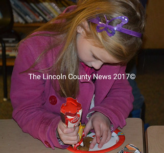 Isabel Leitzell takes decorating her gingerbread man cookie very seriously during the Winter Wonderland celebration at the Wiscasset MIddle School. (Kathy Onorato photo)