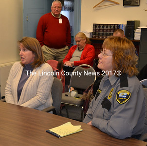 Sue McLeod (left) and Sue Sutter update commissioners on the programs at Two Bridges Regional Jail Dec. 17.  (Kathy Onorato photo)
