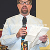 South Bristol Postmaster Wayne Benner, wearing one of his signature Flintstones neckties, addressess an audience of nearly 200 who attended the retirement program hosted by the South Bristol Historical Society at the South Bristol School gymnasium July 16. (Tim Badgley photo)